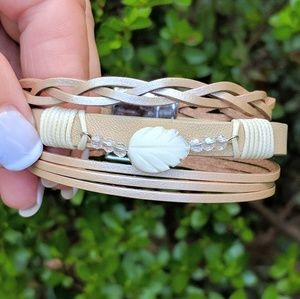 Gold leather bracelet with mother of pearl leaf